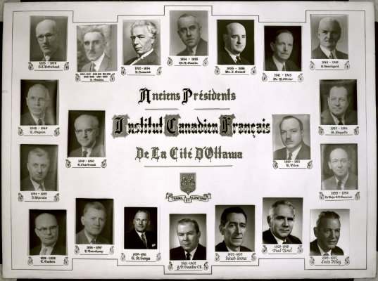 Photograph of a display board with 20 black and white studio photographs, each depicting a man in a suit, in profile or full face view. Names and dates of his presidency appear under the photographs. A title is printed in large black characters preceded by dropped capital letters. Coat of arms and motto are displayed.