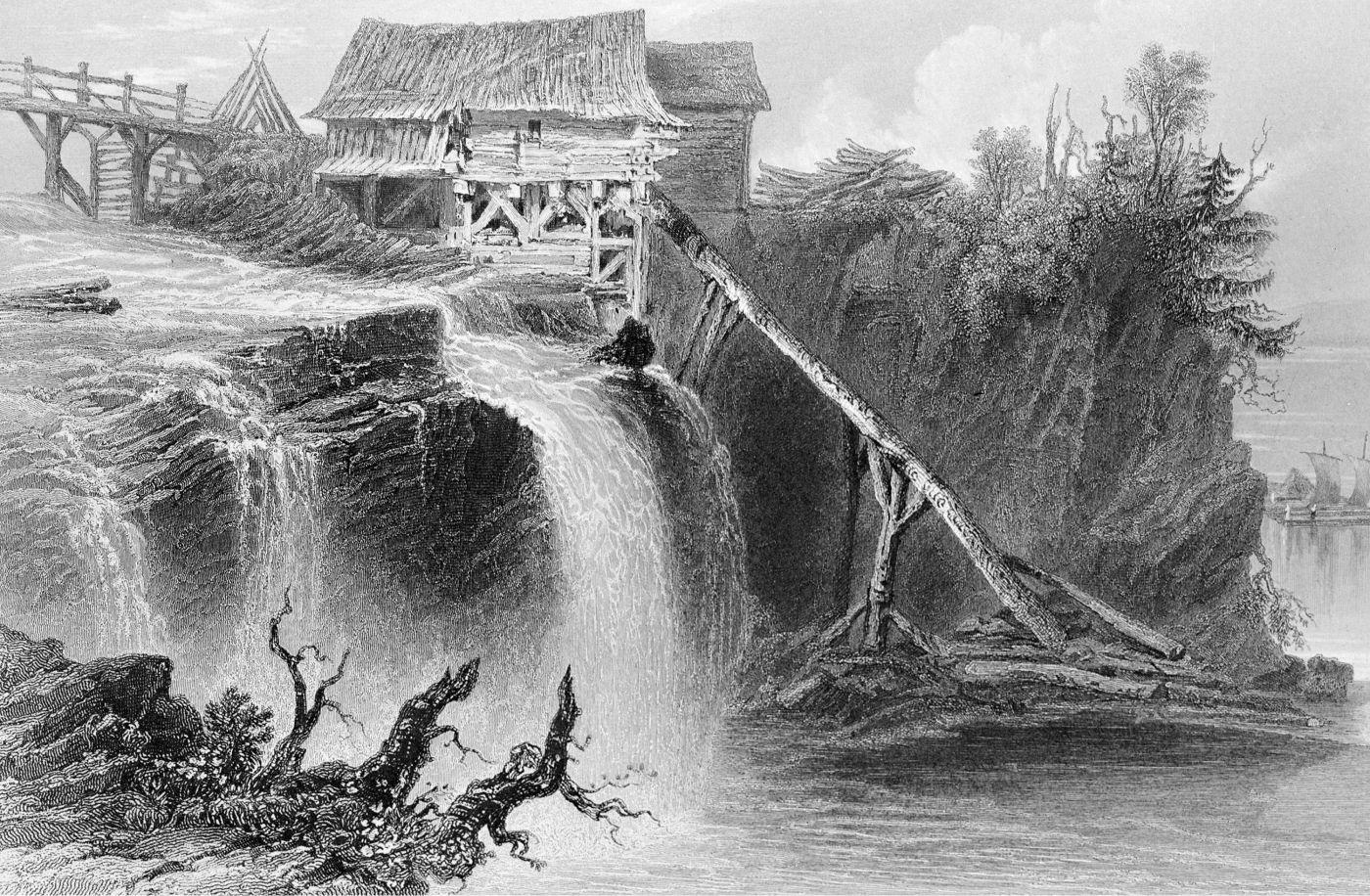 Gravure en noir et blanc d'une petite installation rudimentaire en bois située à proximité de chutes d'eau. Le moulin est situé entre un pont de bois et une falaise boisée.